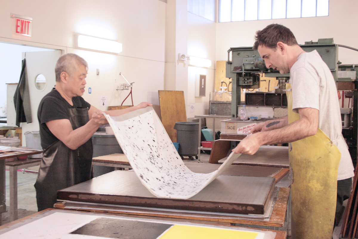 Joseph Hart and Studio Collaborator Paul Wong working together in the Dieu Donné wet studio