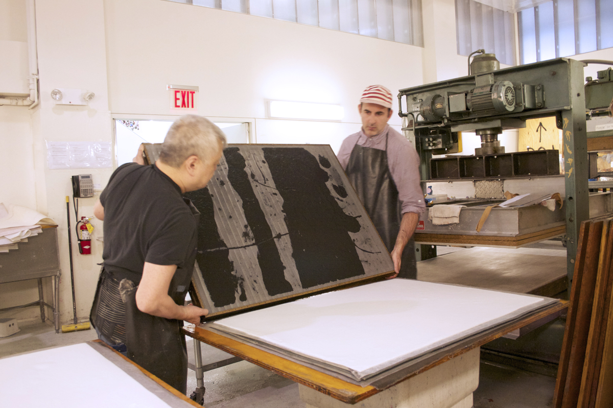 Joseph Hart and Studio Collaborator Paul Wong preparing to lay pulp paint on cotton base sheet
