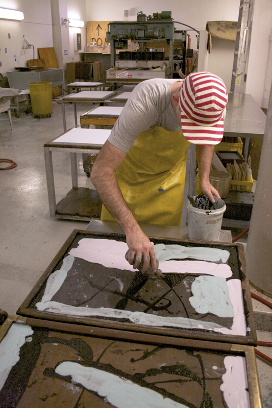 Joseph Hart using pigmented linen pulp paint in the Dieu Donné wet studio
